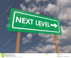 next-level-sign-business-directional-arrow-blue-sky-cloudscape-background-34610357[1]